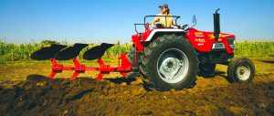 small farm tractor with attachment